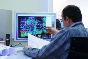 Engineer looking at computer screen
