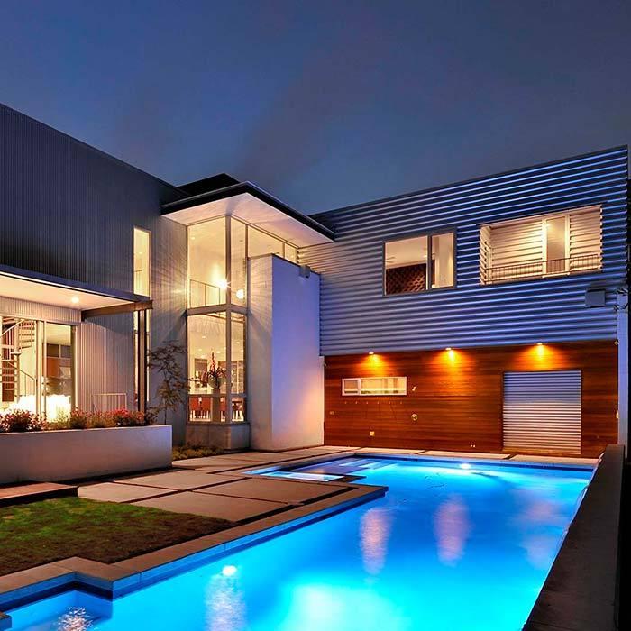 Modern villa and pool at night